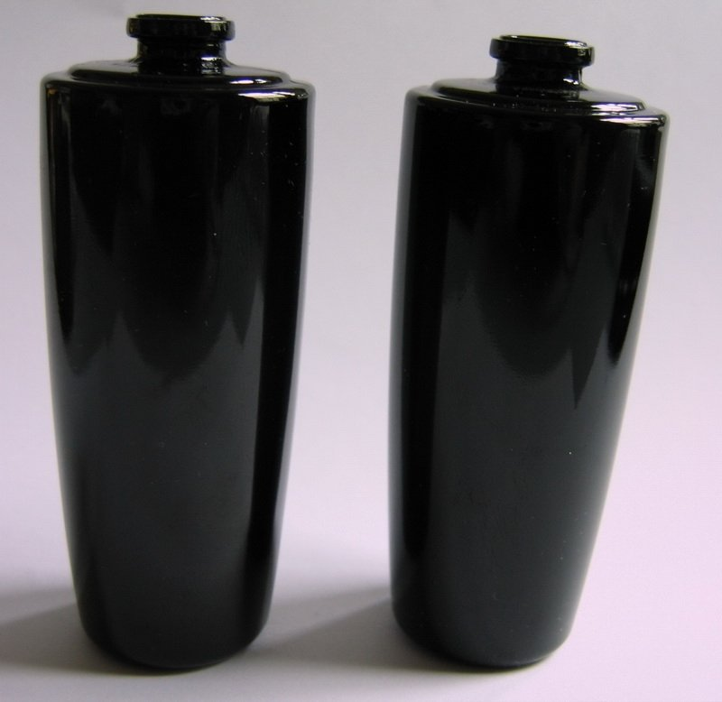 black colored glass bottle